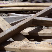 Close up image of wooden boards at a construction site.